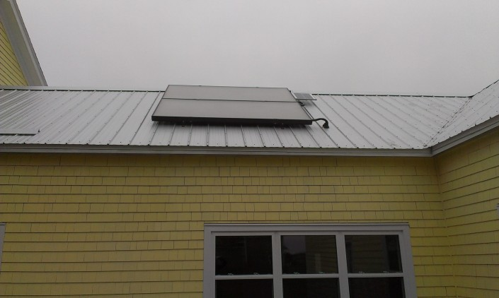 Solar hot water heater and photovoltaic panel on the roof at Open Sky.